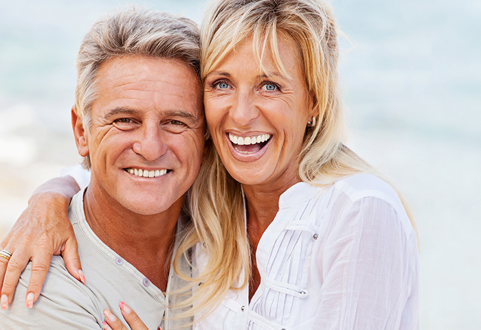 Mature couple smiling Incredible Smiles - Dr Alyssa Ellsworth, DDS specializing in cosmetic dentistry and general dentistly Incredible Smiles; DDS specializing in cosmetic dentistry serving the Front Range, CO call 303-499-0013